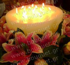 Big candle surrounded by oriental lilies